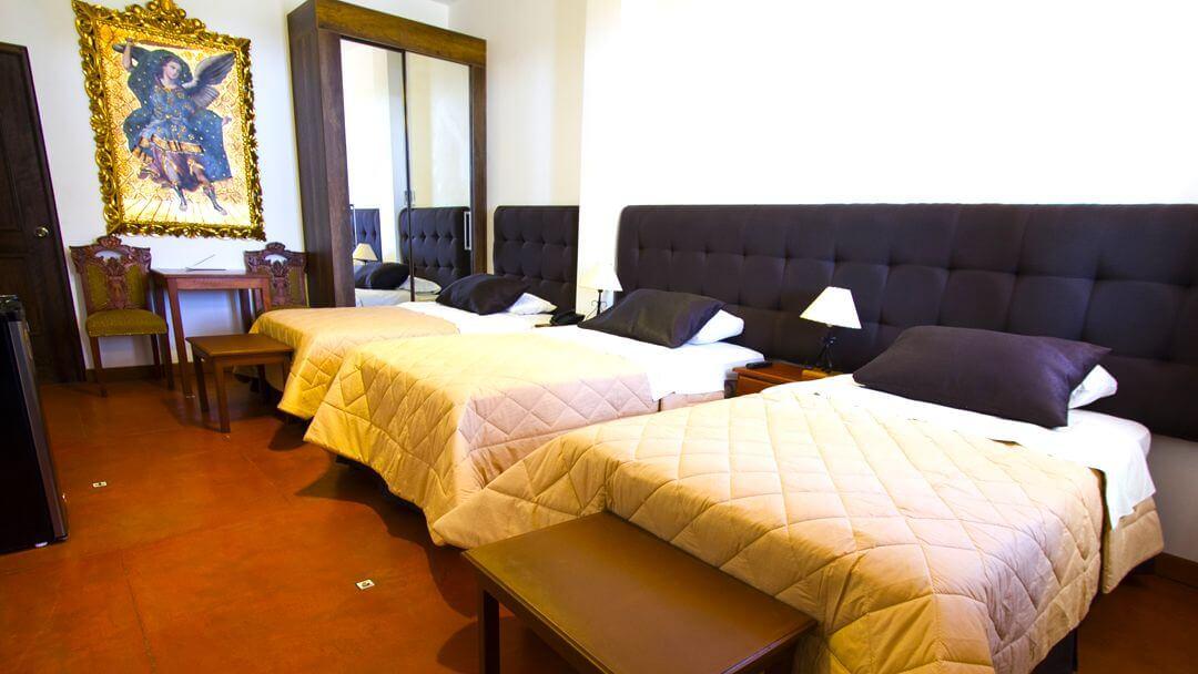 Comodidad garantizada en las habitaciones triples de Casa Hacienda Nasca Oasis